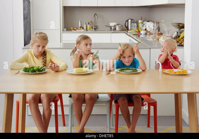 Children refusing to eat vegetables - Stock Image
