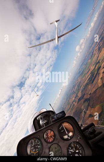 Veiw from the rear seat of a Schempp-Hirth Duo Discus glider, soaring with a Ventus 2CT - Stock Image