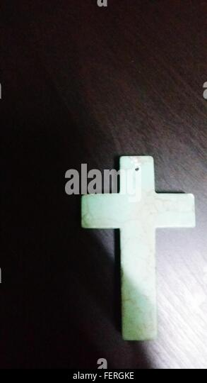 Cross Pendant On Wooden Table - Stock Image