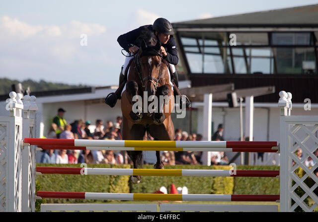 Harrogate, North Yorkshire, UK. 9th July, 2014. A rider clearing a jump during the Rudding Park Great Yorkshire - Stock Image