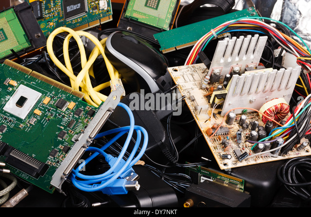 Old power supply, cables, hard drive in trash. - Stock Image