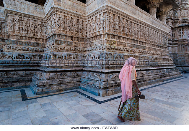 Jagdish Temple is carved with figures of Vishnu, Krishna and Apsaras. - Stock Image