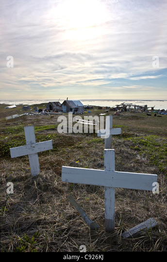 Grave markers on knoll above hunting camp on Shishmaref Island, Arctic Alaska, Summer - Stock Image