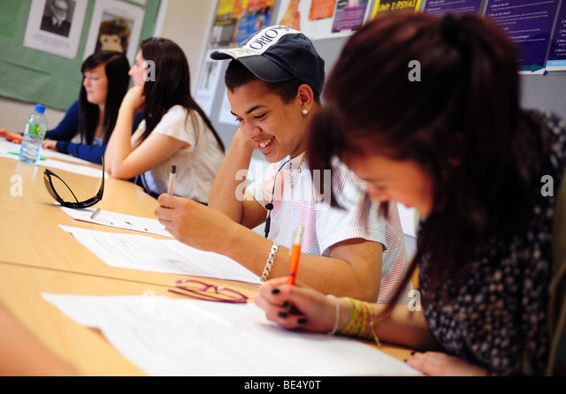 Young black male student at sixth form further education college - Stock Image