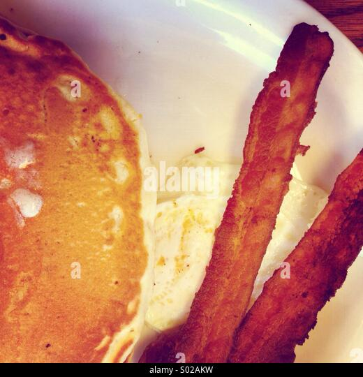 Pancakes, bacon and egg breakfast - Stock Image