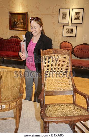 Arkansas Little Rock Historic Arkansas Museum period furniture woman display preserve past antique regional wooden - Stock Image