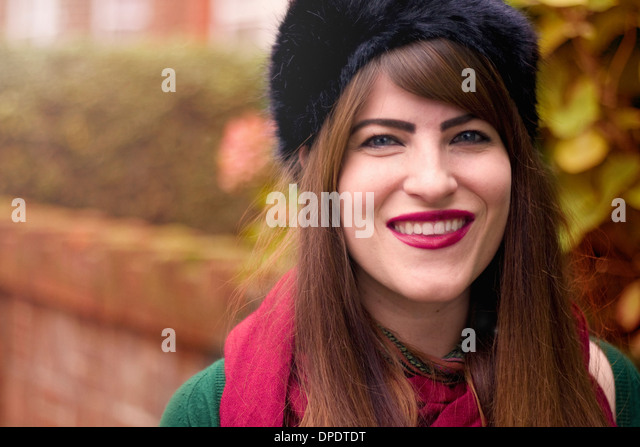Portrait of young woman wearing winter clothing - Stock Image