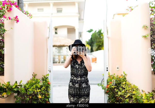 Woman taking photos during vacations - Stock Image