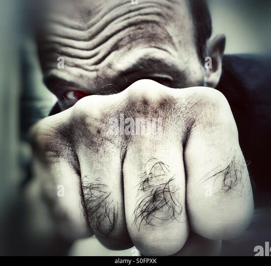 Man punching - Stock Image