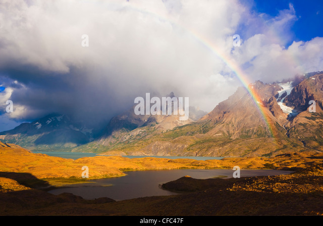 Rainbow and Cuernos del Paine at Sunrise, Torres del Paine National Park, Patagonia, Chile - Stock-Bilder