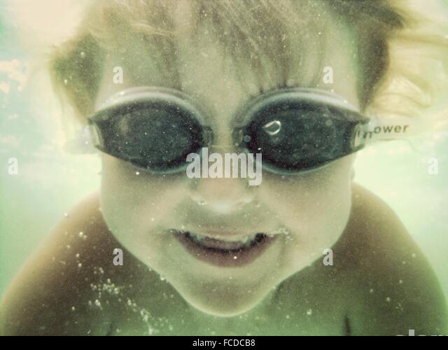 Close-Up Of A Boy Swimming Underwater - Stock Image