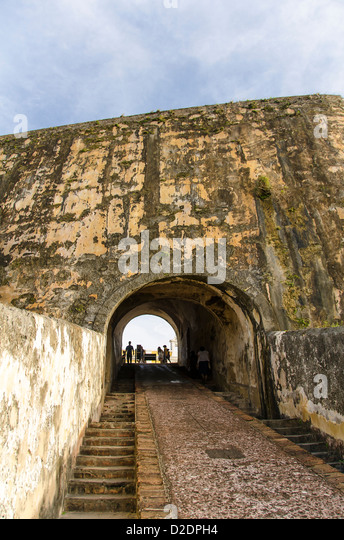 Castillo San Felipe del Morro fortress silhouette of tiny people inside arch, Old San Juan, Puerto Rico - Stock Image
