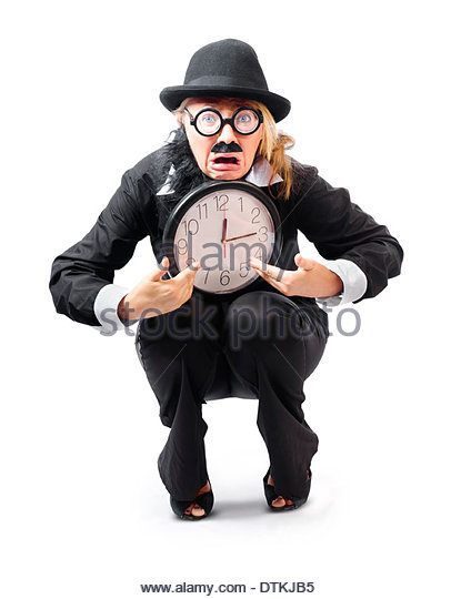 Businesswoman in black bowler hat and with fake mustache and beard looking distraught and crouching down holding - Stock Image