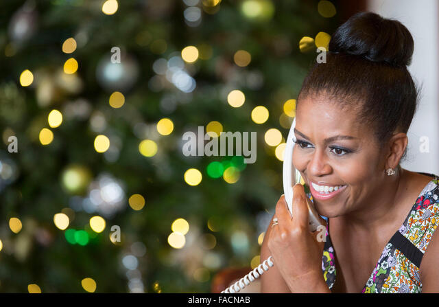 US First Lady Michelle Obama smiles while talking on the phone to children across the country as part of the annual - Stock Image