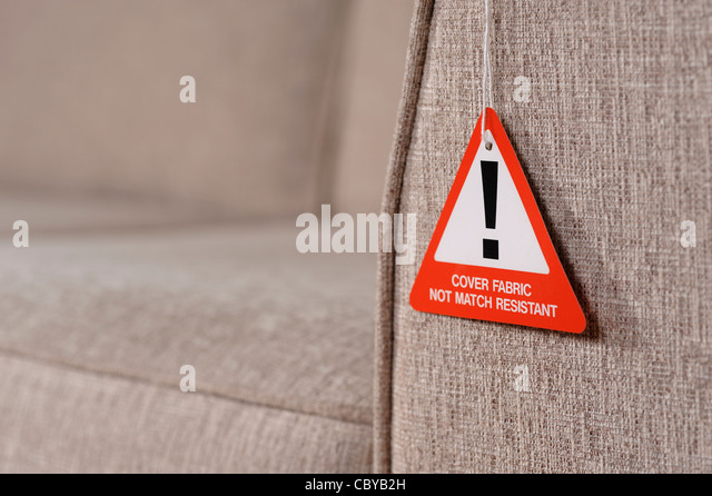 Sofa fire safety warning label - Stock Image