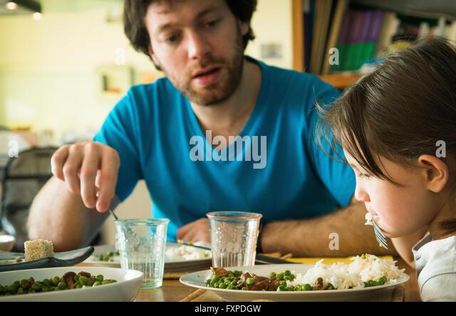 Little girl refusing to eat her dinner - Stock-Bilder