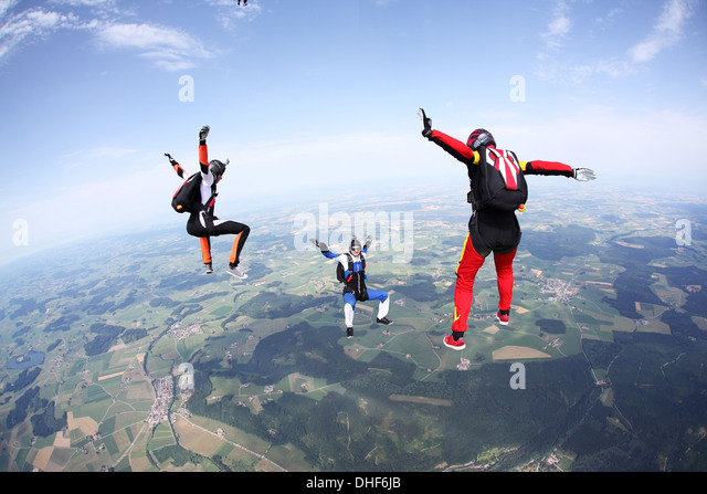 Three skydivers free falling above Leutkirch, Bavaria, Germany - Stock-Bilder