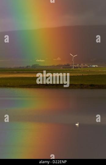 Rainbow with wind turbine, Orkney isles - Stock Image