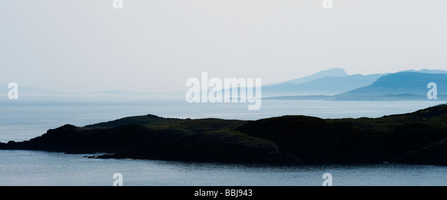 Hazy blue eastern coastline and sea, South harris, Isle of Harris, Outer hebrides, Scotland. Panoramic - Stock Image
