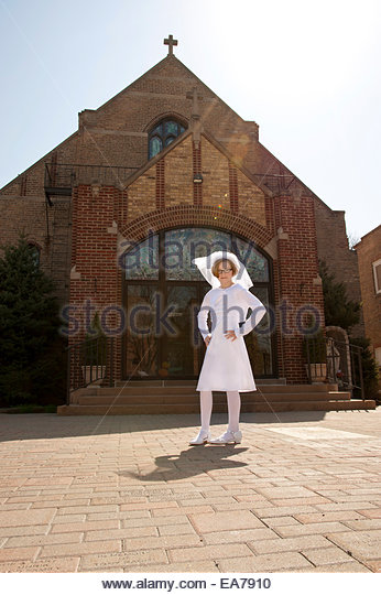 Portrait of girl (8-9) in  first communion dress - Stock Image