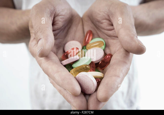 Male doctor's hands showing prescription pills, Bavaria, Germany - Stock Image