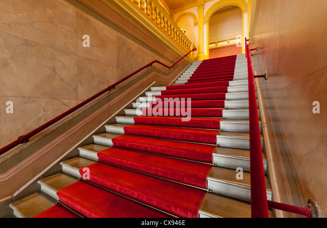 Red carpet lined stairs - Stock Image