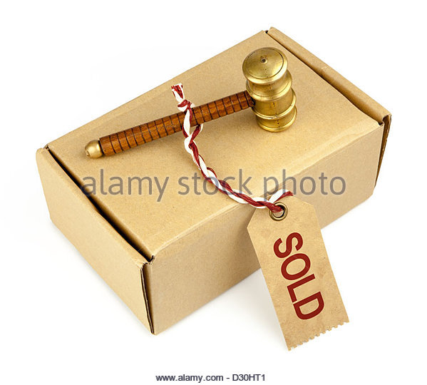 auction hammer and blank cardboard box with label - Stock Image