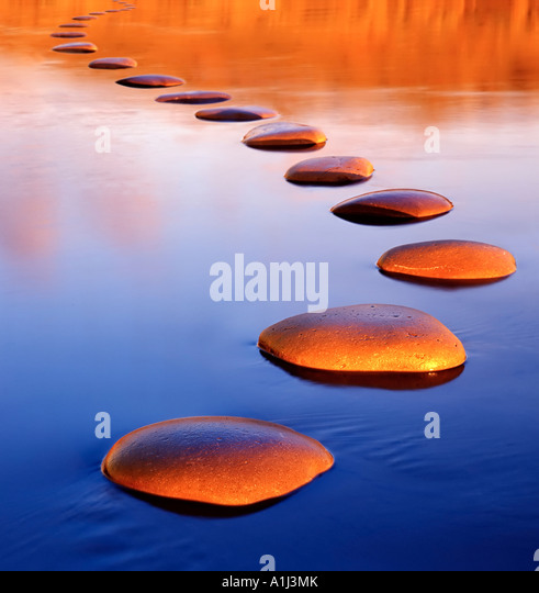Stepping stones provide a safe passage through deep water - Stock-Bilder