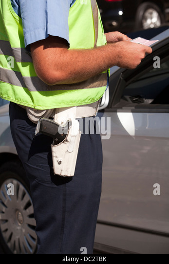 police officer controls driver's license - Stock Image