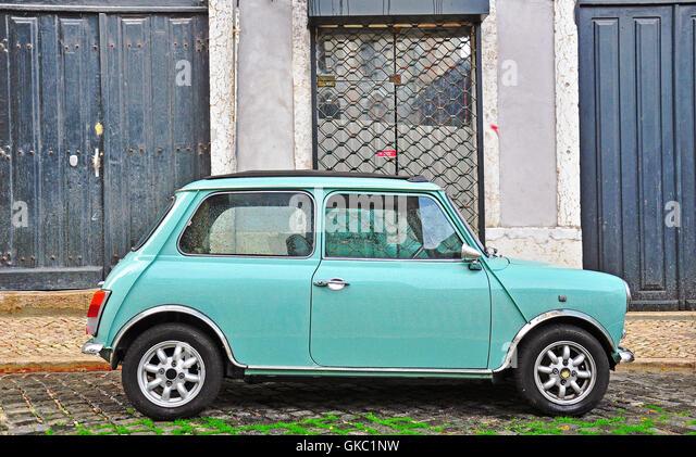 LISBON - DECEMBER 25, 2012: Old fashioned light blue Mini in the street of Lisbon on December 25, 2012. - Stock Image
