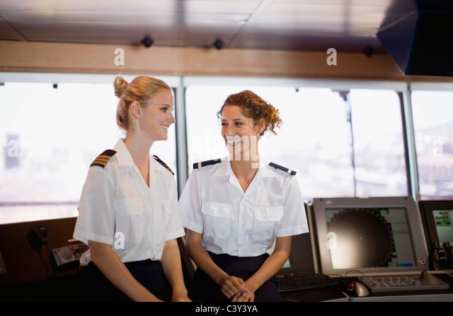 Female salors talking on ship - Stock Image