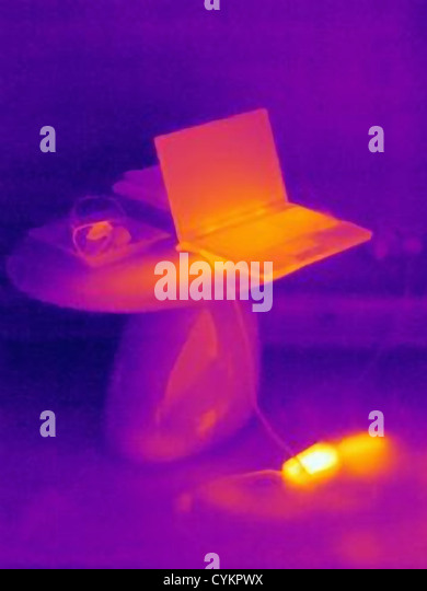 Thermal image of laptop charging - Stock Image