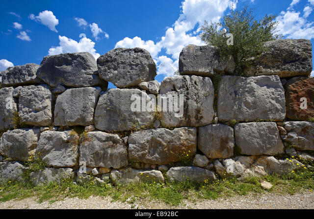 ´Gigantic´´ stone wall of the Mycenaen archiological site of Tiryns - Stock Image