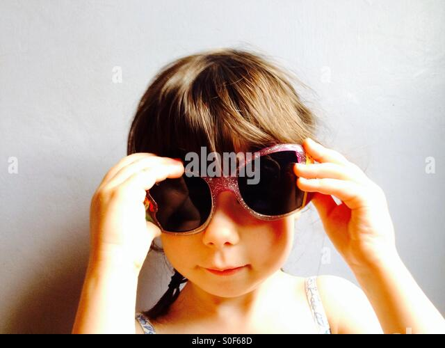 3-year old girl wearing sunglasses - Stock Image