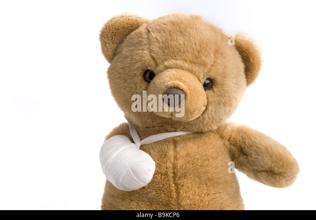 Toy bear with a broken leg - Stock Image