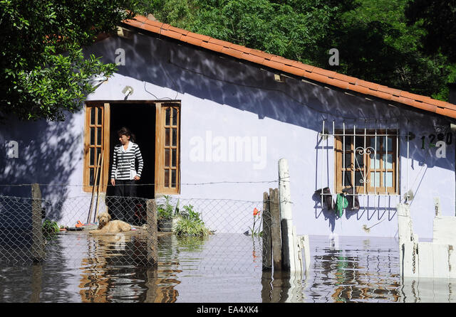 Buenos Aires, Argentina. 6th Nov, 2014. A resident looks on from her house after heavy rain, in Buenos Aires Province, - Stock Image