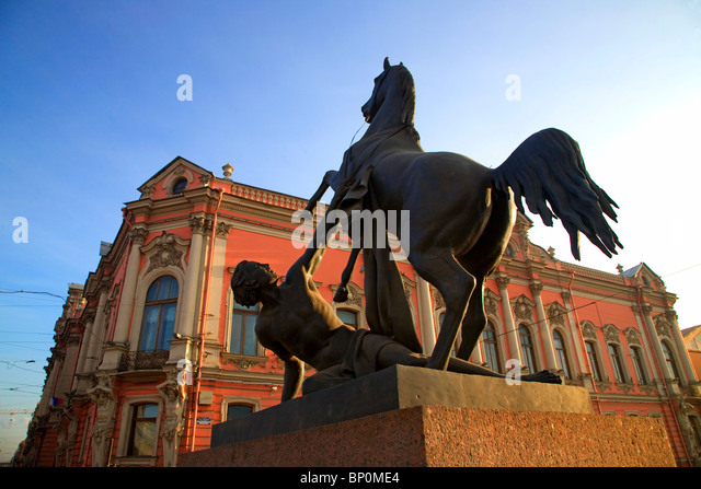 Russia, St. Petersburg; One of the four horse sculptures on the Anitchikov Most on Nevski Prospekt - Stock Image