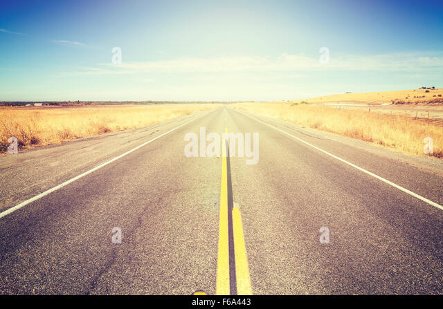 Vintage toned endless country road, travel concept picture. - Stock-Bilder