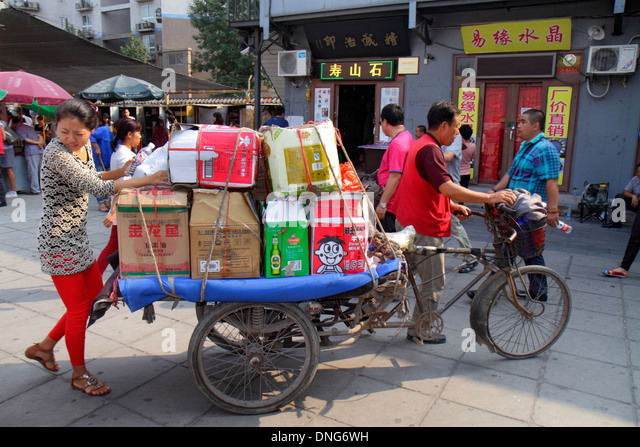 Beijing China Chaoyang District Panjiayuan Weekend Dirt Flea Market shopping selling buying display sale vendor - Stock Image
