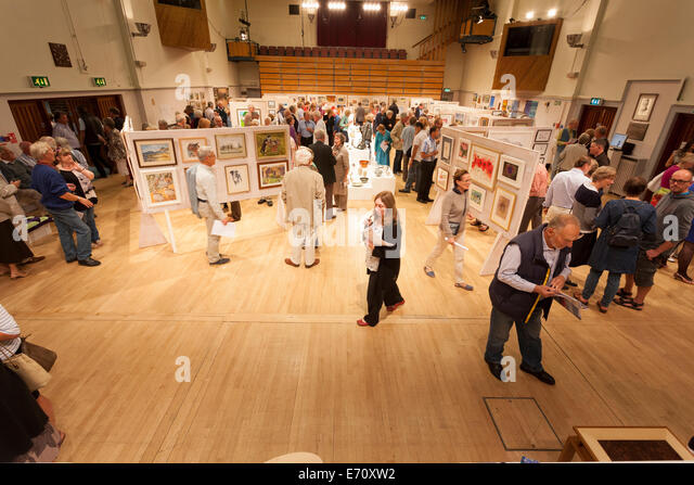 Guests crowd the exhibition hall to view the exhibits at the Petersfield Arts and Crafts 2014 Exhibition preview - Stock Image