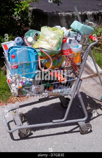 Miami Beach Florida Alton Road shopping cart homeless empty bottles trash - Stock Image