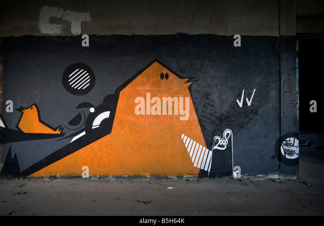 A piece of graffiti in a brownfield site factory. Graffiti dans une usine désaffectée. - Stock Image