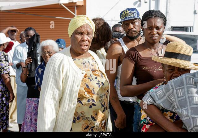 Miami Florida Little Haiti Thanksgiving Turkey Give-Away give away Haitian Black woman women man senior assistance - Stock Image