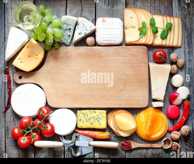 Various types of cheese with empty space background concept - Stock Image