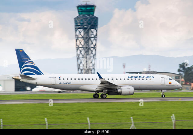 A Copa Airlines Colombia Embraer E190AR accelerates down the runway at El Dorado International Airport, Bogotá, - Stock Image
