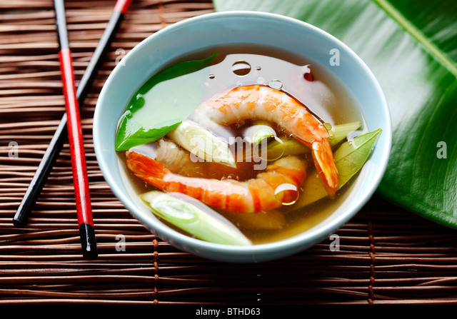 asian shrimp soup with kaffir leaves and spring onions - Stock Image