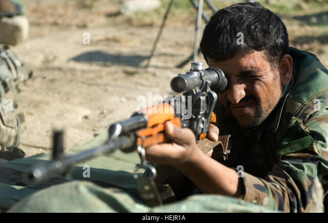 An Afghan National Army soldier practices aiming his SVD-137 Dragunov sniper rifle during a U.S. Army hosted sniper - Stock Image