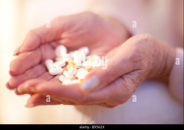 Handful of pills - Stock Image