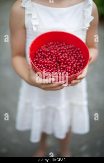 girl with bowl of red currant. ripe, berries, child, food. - Stock-Bilder