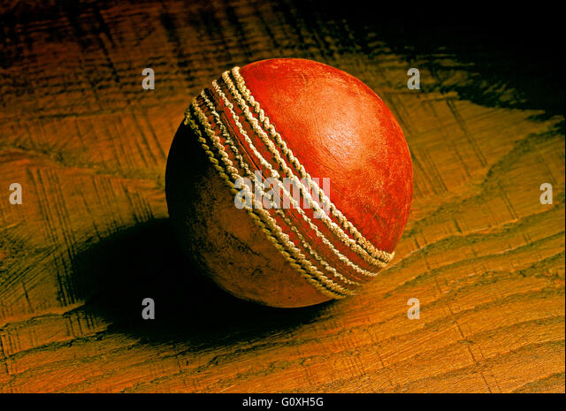 Cricket Ball Red leather old and used cricket ball - Stock-Bilder